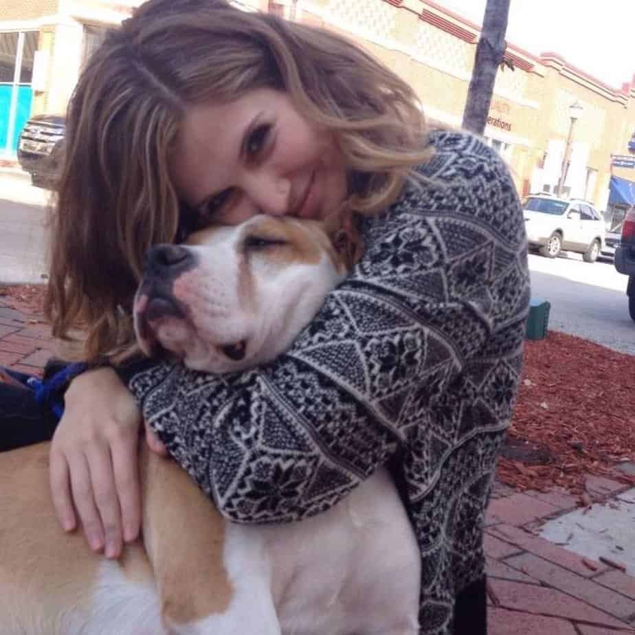 University of Missouri (Mizzou) student Riley Newson hugging a dog