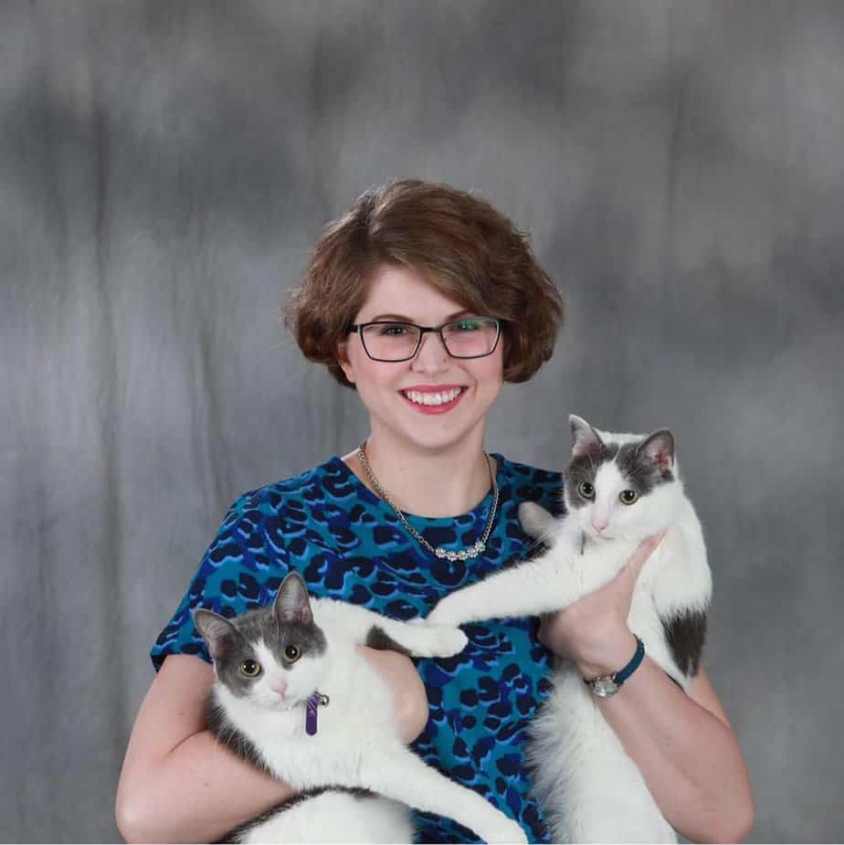 University of Missouri Riley holding her 2 cats