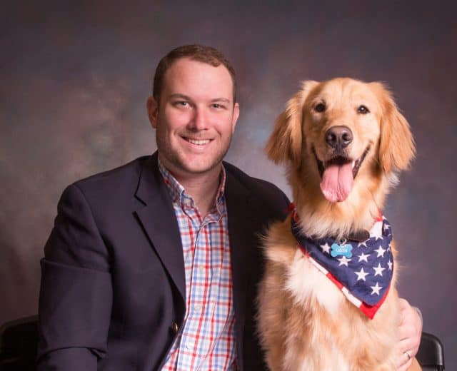 David a former veterinary assistant and now a DVM student and his dog.