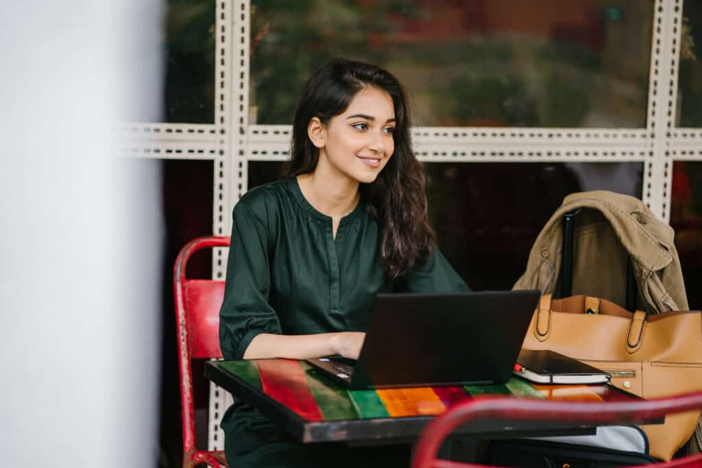 A student sitting at a desk applying for internships.