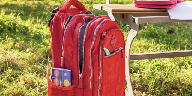 Red rolling bookbag for college